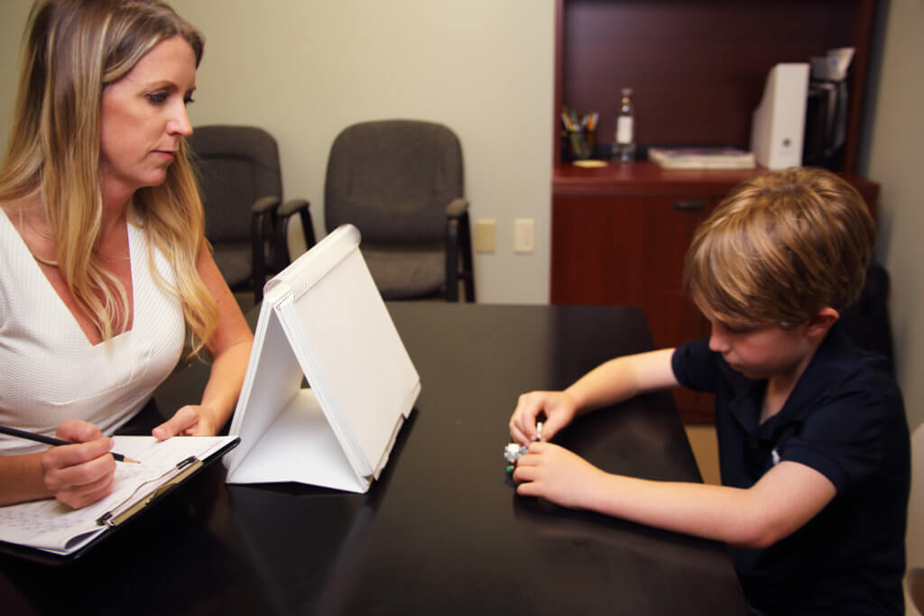 Dr. Kelderman observes a child as a part of a neuropsychological evaluation.