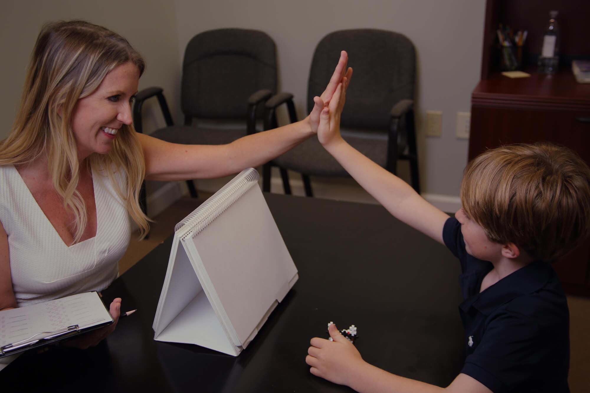 Dr. Kelderman exchanges a high-five with a patient.